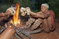 Bushmen dancing at a camp fire